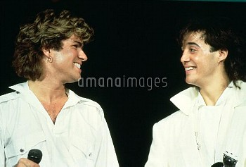 George Michael and Andrew Ridgeley of Wham performing live in the mid 1980's.© Michael Putland / R