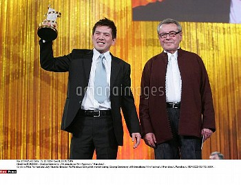 Milos Forman and Jury Prize to director Ma Mendoza (Slingshot movie) during Closing Ceremony of Inte