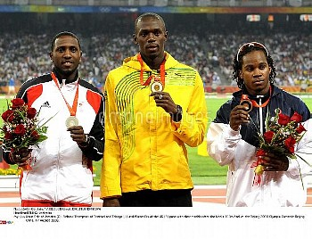 Usain Bolt of Jamaica (C), Richard Thompson of Trinidad and Tobago (L) and Walter Dix of the US (R)