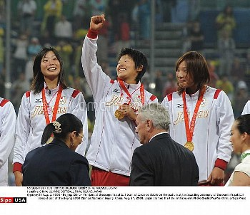 21 August 2008 - Beijing, China - Members of the women's softball team of Japan celebrate on the pod