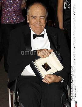 "Italian Director Bernardo Bertolucci with his ""Palme d'Honneur"" attends the opening night dinner dur"