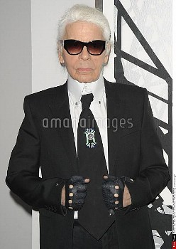 German fashion designer, artist and photographer Karl Lagerfeld poses during a visit to an exhibitio