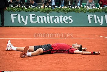 Serbia's Novak Djokovic reacts after winning the men's final match at the Roland Garros 2016 French