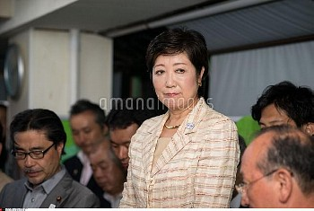 Yuriko Koike, newly elected governor of Tokyo, center, celebrates after she speaks during a news con