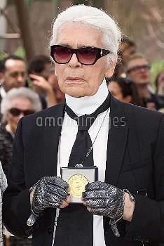 Paris Mayor Anne Hidalgo gives to Karl Lagerfeld the 'Medaille Vermeille de la Ville de Paris' after