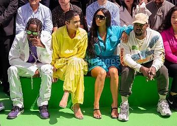 (L-R) Travis Scott, Kylie Jenner, Kim Kardashian and Kanye West attend the Louis Vuitton Menswear Sp