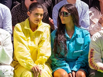 (L-R) Kylie Jenner and Kim Kardashian attend the Louis Vuitton Menswear Spring/Summer 2019 show as p