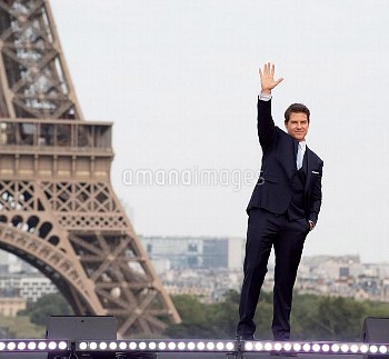 "Actor Tom Cruise poses in front of the Eiffel Tower during the ""Mission: Impossible - Fallout"" Globa"