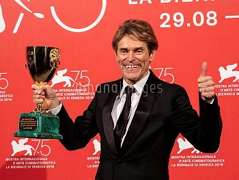 Willem Dafoe poses with the Coppa Volpi for Best Actor for 'At Eternity's Gate' at the Winners Photo