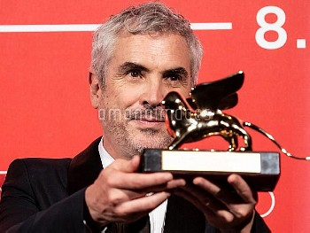Alfonso Cuaron poses with the Golden Lion for Best Film Award for 'Roma' at the Winners Photocall du