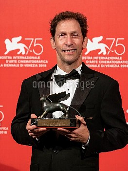 Tim Blake Nelson poses with the Best Screenplay Award for 'The Ballad Of Buster Scruggs ' at the Win