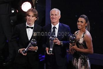 Brazil's Marta, left, who received the Best FIFA Women's player award France's Didier Deschamps, Bes