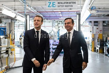 Emmanuel Macron and Carlos Ghosn. French President Emmanuel Macron during a visit of the Renault fac