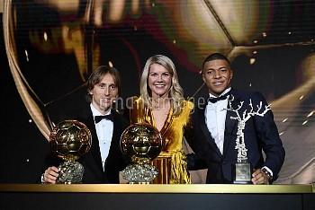 Real Madrid's Luka Modric Olympique Lyonnais' Ada Hegerberg Paris St Germain's Kylian Mbappe with th