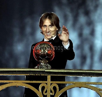 Real Madrid's Luka Modric with the Ballon d'Or award Golden Ball (Ballon d'Or) award ceremony at the