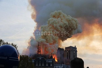 The Spire of Notre Dame collapses amid the flames which engulfed the roof of the Cathedral. Paris -