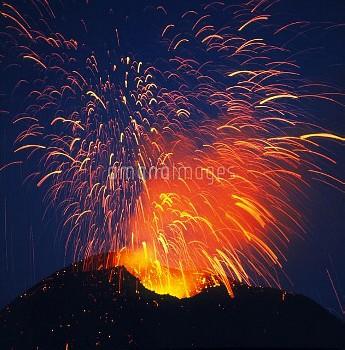 Mount Etna erupting at night