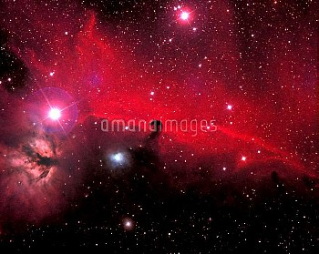 "The constellation Orion contains a wealth of gas, dust and stars. Near the ""belt stars"" appears a sw"