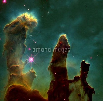 Gas pillars in the Eagle Nebula. Hubble Space Telescope image showing dark pillars of dense molecula
