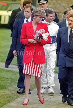 NATIONAL PICTURES    Stock full length shot of Diana in a red jacket and red and white striped skirt
