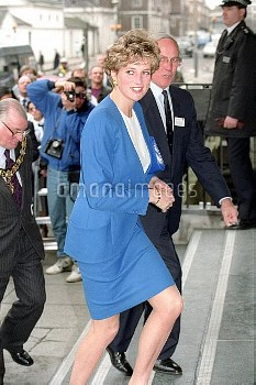 NATIONAL PICTURES    Diana walks up some steps wearing blue suit and white blouse.   Venue and event