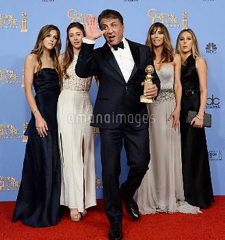 Sylvester Stallone wins an award at the 73rd annual Golden Globe Awards in Beverly Hills