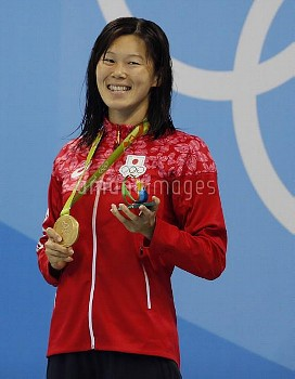 Rie Kaneto smiles holding her gold medal at Rio Olympics