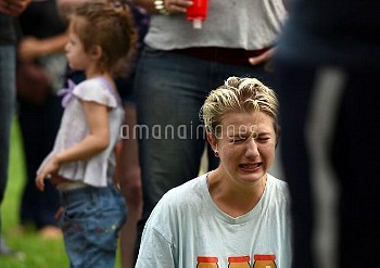 ORLANDO, June 13, 2016 (Xinhua) -- A woman cries during a vigil to mourn the victims of the mass sho