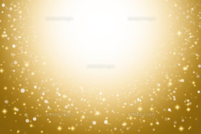 ゴールドの背景とキラキラと輝く星10132108650の写真素材イラスト
