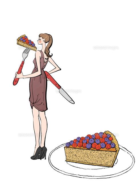 ナイフとフォークでケーキを食べるワンピースの女性10402000562の写真
