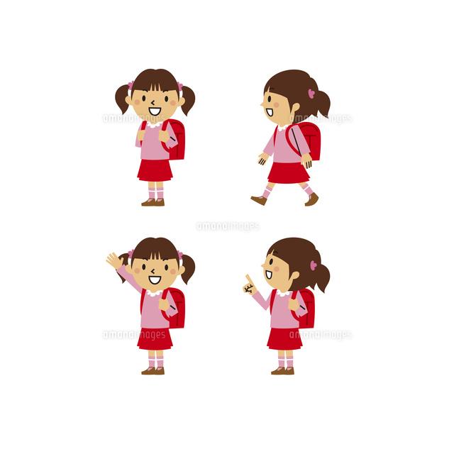 小学生の女の子私服笑顔登校指差し10423001112の写真素材