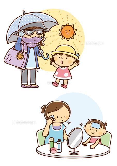 日焼け対策をする母親と子供肌の手入れをする親子10468000388の写真