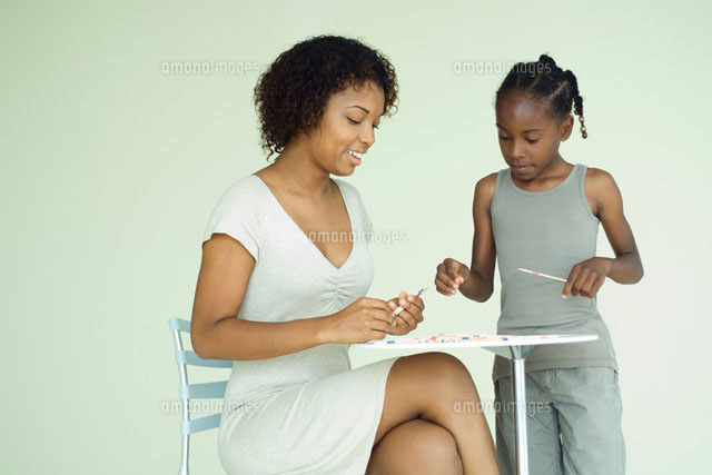 Mother & daughter playing pick up sticks