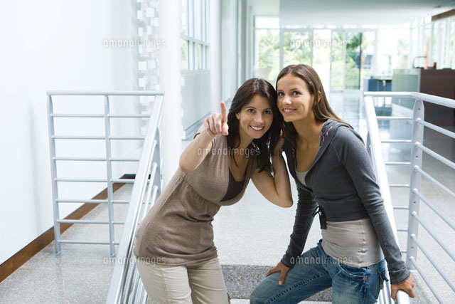 Woman standing on stairs with daughter