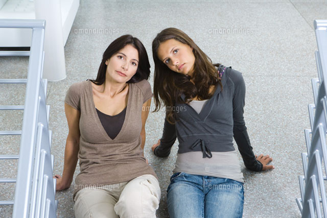 Mother & daughter sitting on the ground