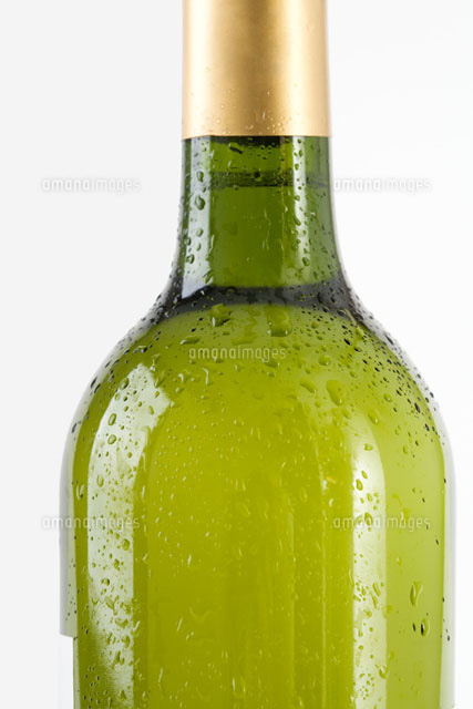 Bottle of white wine covered with drops of water