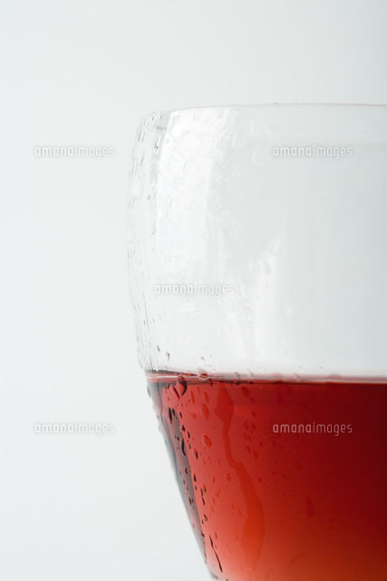 Glass of chilled rose wine, close-up