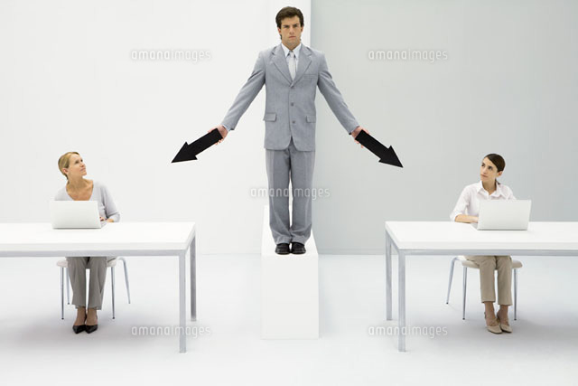Businessman standing between two female employees