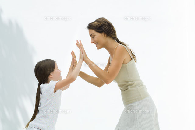 Mother and daughter playing clapping game together