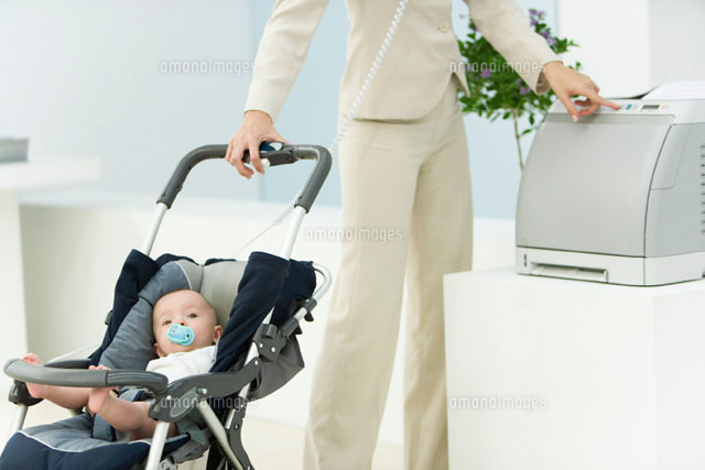 Professional woman in office with baby in stroller