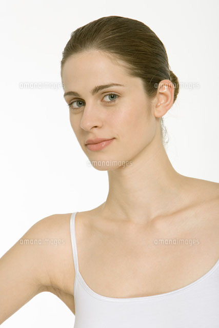 Woman with hair in bun,wearing white tank top,portrait