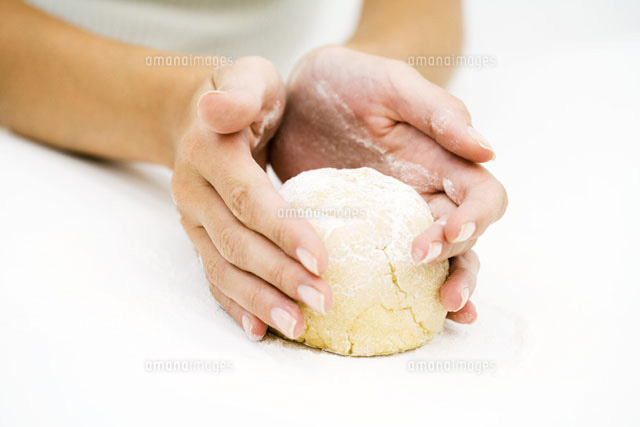 Woman kneading dough,cropped view of hands