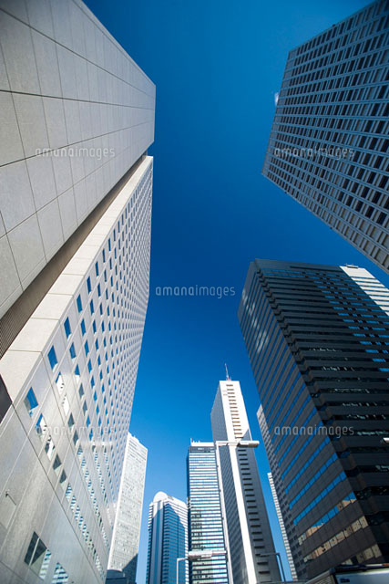 a low angle view of skyscrapers in Tokyo