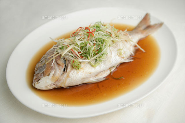 Steamed fish in a white plate
