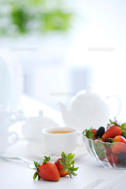 Close up of tea set and berries