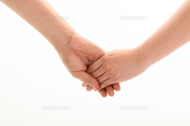 Man and woman 's hands together