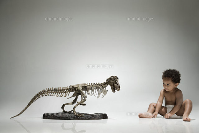 Boy and a dinosaur skeleton