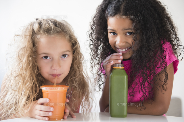 Girls drinking healthy smoothies