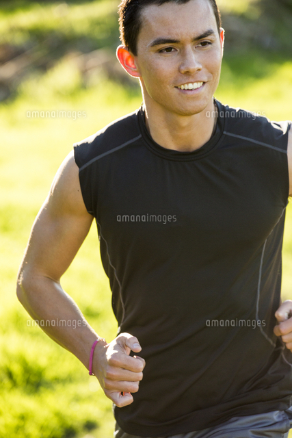 Smiling Mixed Race man running