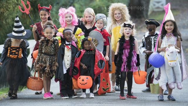 Portrait of children wearing costumes on Halloween